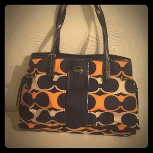 Coach hand bag orange with navy blue
